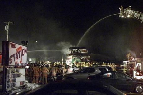 Firefighters sprayed water onto the charred remnants of the nightclub.