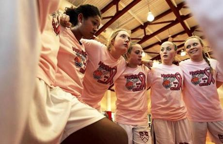 Katharine Fogarty, second from left, with her teamates in a pre-game huddle before a basketball game in Concord, N.H.