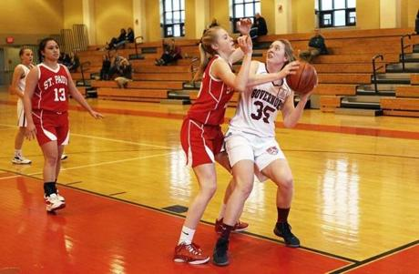 Katharine Fogarty, right, looks to pass during a basketball game against St. Paul's School.