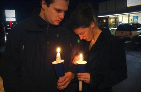 Wayne LaPoint of Warwick R.I., and his girlfiend, Connie Ribera of North Kingston, joined a candlelight vigil last night.
