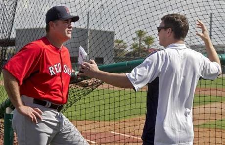 Manager John Farrell (left) talked with general manager Ben Cherington after the second day of spring training.