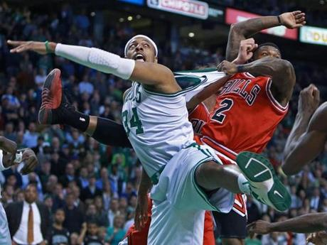 The Bulls' Nate Robinson,right, had a good grip on Celtics captain Paul Pierce as they battled under the boards during the final frantic seconds of the game at the TD Garden.