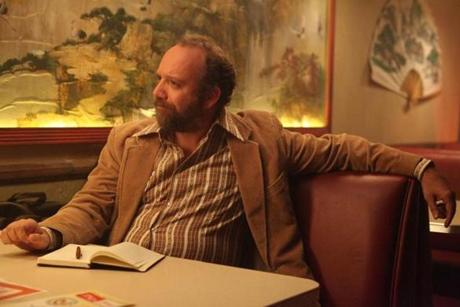 Paul Giamatti plays a reporter.