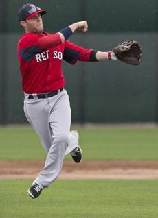 Dustin Pedroia went airborne on his follow through after throwing to first base.
