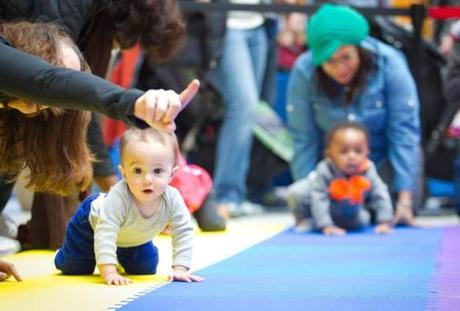 Nine-month-old John Yanovich of Weymouth ignored the lanes and went freestyle width-wise across the racing floor in the 4th Annual Diaper Derby. He was gently directed toward the finish by race organizer Laura Hendry, and though he never officially finished, he was in good spirits the whole time. The event took place at the South Shore Plaza in Braintree.
