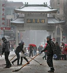 Despite the inclement weather, Chinese New Year festivities took place all over Chinatown in Boston. People shoveled and swept off Beach Street for the Lion Dance Parades and for pedestrians.