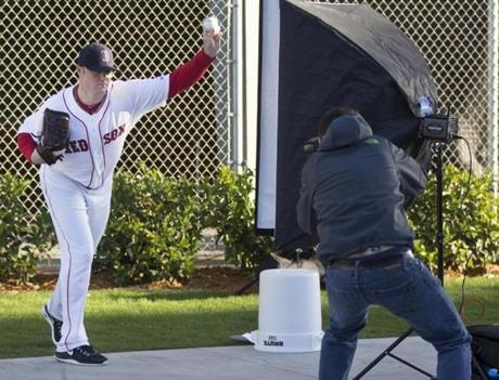 Jon Lester posed as a photographer took his photo.