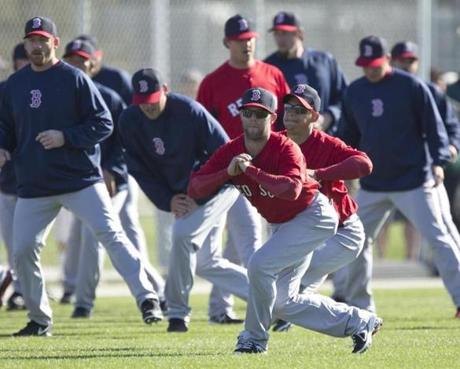 Dustin Pedroia stretched in front of prospect Jose Iglesias.