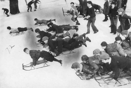 December 29, 1935: Christmas sleds were out in force as youngsters enjoyed coasting on the hills of Boston Common.
