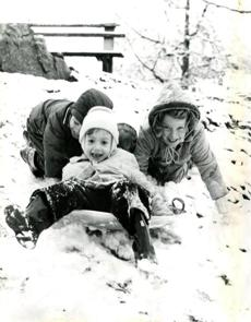 November 28, 1959:  Judy Kirstead, 4, started down a snow-covered Malden hill on a sled with the help of a healthy shove from Paul Farrel, 5 (behind) and her sister, Mary Ann Kirstead, 6 (right). A quick-hitting and fast-leaving storm gave Greater Boston just enough snow to be labeled its first snow storm of the season.