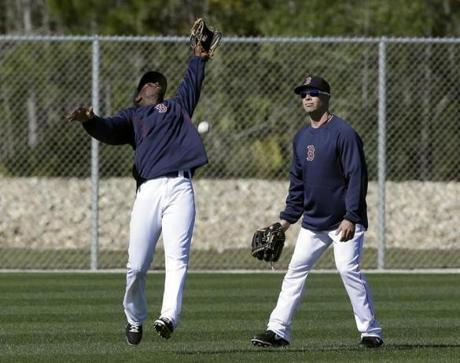 Pedro Ciriaco, left, missed a catch near Daniel Nava.