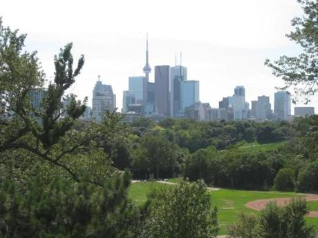 CN Tower was the world's tallest tower when it was built in 1976 and remains Toronto's downtown landmark, here seen from across Riverdale Park and Queen Street.