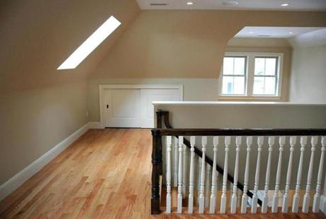 The third floor hosts the family room with skylights joining four windows to pull natural light in, and the large fourth bedroom.