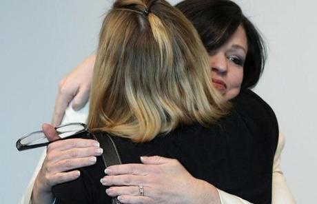 Nathaniel Fujita's mother, Beth Mattingly-Fujita (right), was embraced during the trial.