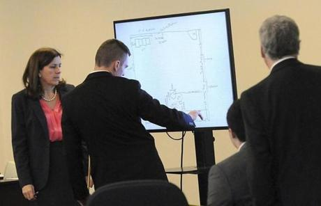 Massachusetts State Trooper David Twomey (center) pointed to a diagram of a detached garage.