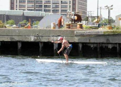 John O'Hara participates in the Boston Tea Paddle at Liberty Wharf last June.
