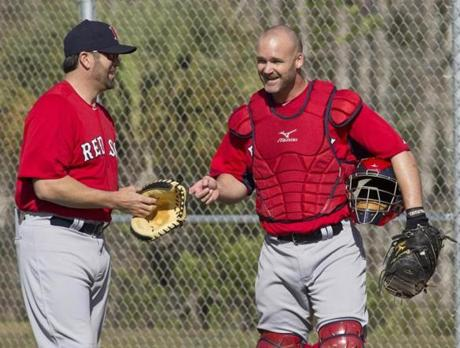 Special assistant Jason Varitek, left, worked with new Red Sox catcher David Ross.