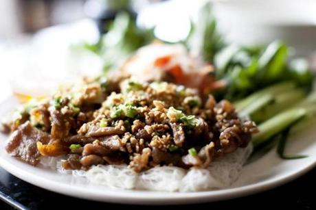Banh hoi pork is fried minced pork on plain vermicelli with vegetables on the side.