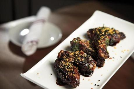 Chicken wings in a soy and hot sesame oil sauce.