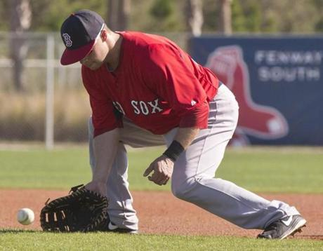 Daniel Nava fielded some ground balls during a workout.