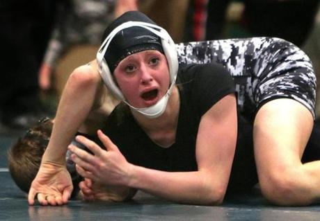 North Andover's Danielle Coughlin reacted after time ran out in her first-place win over Winchester's Jordan Darby in the 106-pound class in the Division 2 state wrestling championship at Marshfield High School.