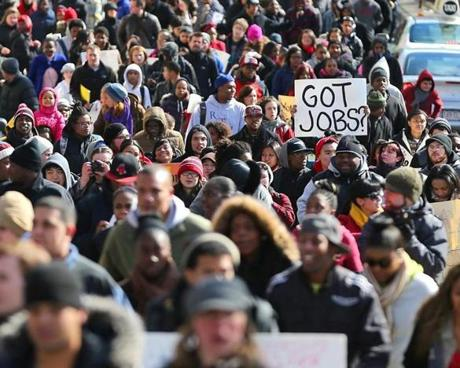 Hundreds of youths held a rally at Faneuil Hall in support of youth jobs funding, and then marched from there to the State House.