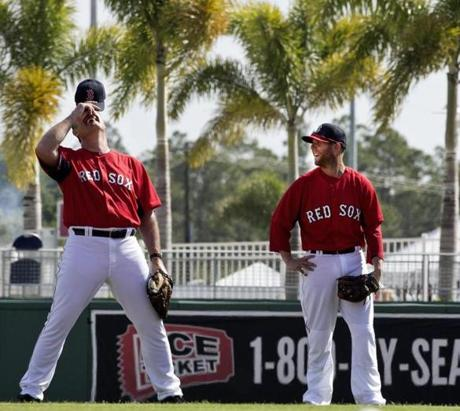 Boston Red Sox manager John Farrell (left) and Dustin Pedroia laughed before the start of their exhibition season opener at JetBlue Park.