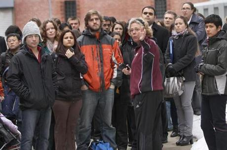 A college worker instructed a group on the lockdown of the campus. A search of a building yielded nothing unusual.