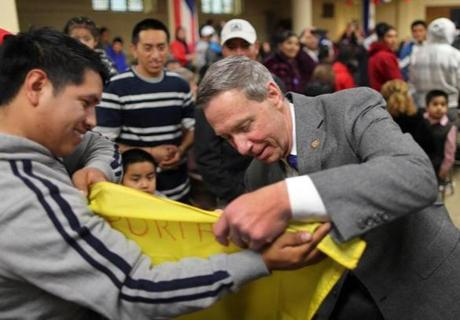 Stephen Lynch signed an Ecuadorian flag after a speech on immigration in Brockton.