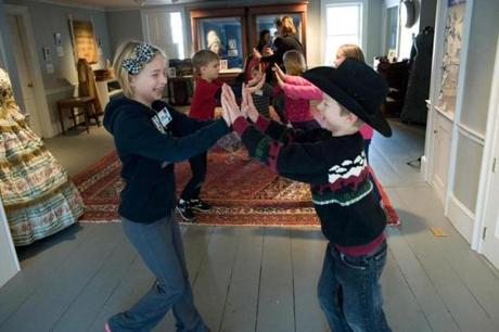 An old time dance broke out on the floor of the Andover Historical Society.