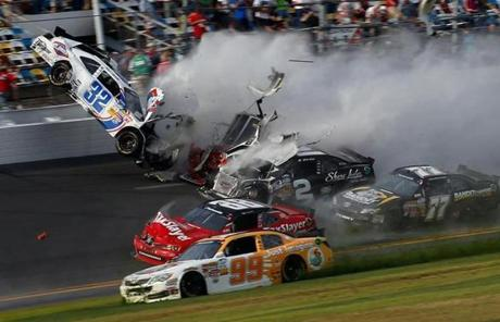 Kyle Larson (32) crashed into the catch fence at the end of the NASCAR Nationwide Series at Daytona International Speedway.