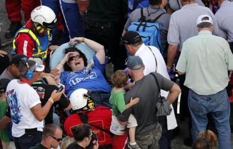 Rescue workers attended to the injured in the stands.