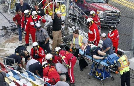 Injured spectators were treated after debris flew into the stands.