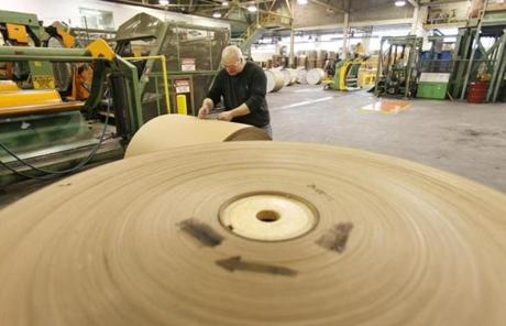 Chris Morin prepared to move an 1,800-pound paper roll. He is among about 200 employees back at work at the Great Northern Paper Co. mill in East Millinocket, Maine.