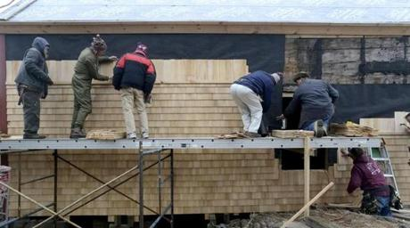 Volunteers work on restoration of fish shack at Lane's Cove in the Lanesville section of Gloucester, Mass. Feb. 23, 2013.