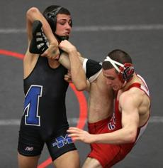 Methuen's Christian Monserrat (left) en route to repeating winning his third championship as he took on Central Catholic's Pat Lacroic  in the 126 pound all-state wrestling championships at Salem High School.