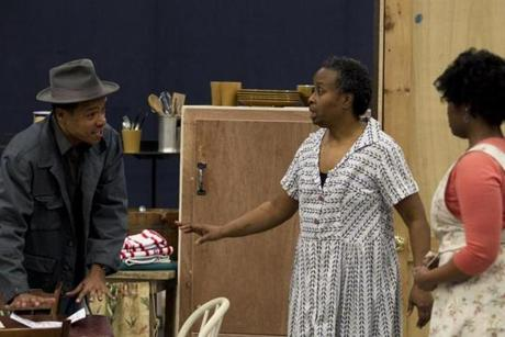"LeRoy McClain, Kimberly Scott, and Ashley Everage rehearsing the Huntington Theatre Company's production of ""A Raisin in the Sun."""