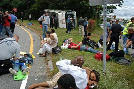 Rescue workers helped passengers after a Fung Wah bus overturned on an Interstate 290 off-ram Sept. 5, 2006 in Auburn.