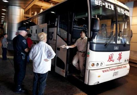 A Fung Wah Bus Company driver passed his paperwork to state inspectors during unannounced bus inspections at the South Station bus terminal on Aug. 24, 2005.