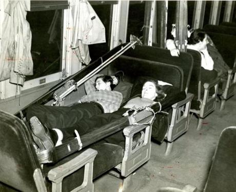 February 6, 1937 / These skiers caught a bit more sleep as their overnight train speeds them northward. They were among the crowd of 400 that jammed the