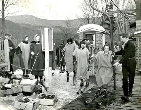 February 17, 1946 / After staying for the night in a nearby ski dormitory operated by the state of Vermont at Stowe, this group of young women lined up to board the chair lift at Mount Mansfield. The girls were wearing peacetime versions of Army ponchos- definitely not form-fitting - as protection against the cold wind for the ride up the mountain. The girls took off their ponchos at the top of the mountain and sent them down in the empty chairs while they skied down the slopes and trails.