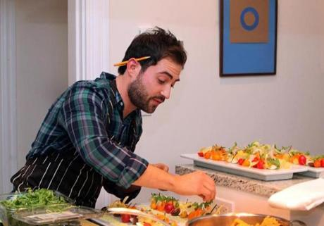 Kitchensurfing, a New York City start-up that this month inaugurated its Boston link, offers a user-friendly site for chef profiles and meals prepared in your home or office. Above, chef Ari Warsaw prepared a salad for the Kitchensurfing Yelp event. prepares a salad for the dinner at his Jamaica Plain apt.