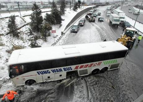 A westbound Fung Wah Bus skidded off the Mass Pike right before the Allston-Cambridge exit on Feb. 14, 2007.