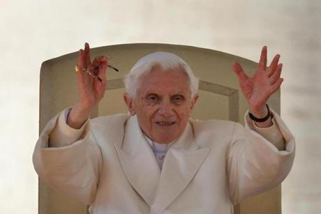 Pope Benedict XVI waved from the altar during his last weekly audience.