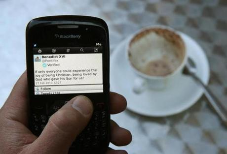 A Blackberry mobile phone displayed Pope Benedict's last tweet.