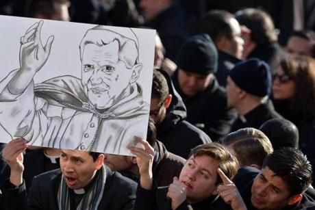 The faithful held a placard with a drawing of Benedict.