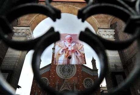 A poster showing Pope Benedict XVI portrait is hanged in front of St. Anthony of Padua Church reading