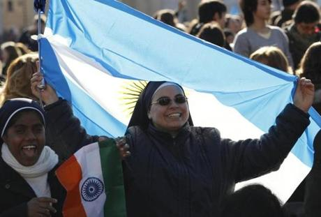 Nuns waved Indian and Argentine flags in St. Peter's Square.