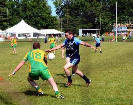 Teams face off in Gaelic Athletic Association football at the Irish Cultural Centre's grounds.