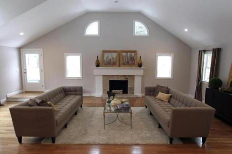 The living room has a working fireplace and a 13-foot ceiling.
